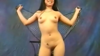 Pretty Oriental slut Miki Chan does a few exotic, naked moving