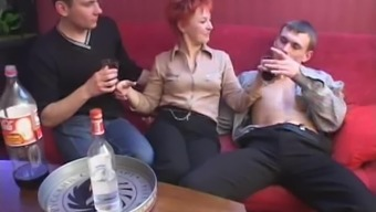 During a party a redheaded MILF takes on four gentlemen immediately