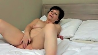 Granny plus a young gorgeous fuck a big red colored dildo simultaneously