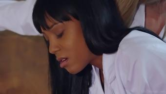 Big tits black lesbian seduces an adorable prolonged haired ebony babe