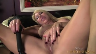Erica Lauren makes her pussy moist with the use of pleasant love-making toys