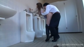 Japanese milf blows and gets fucked in a public bathing room