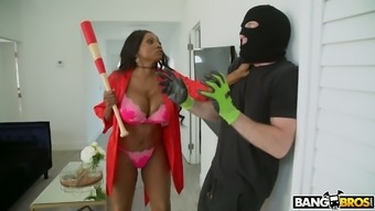 Gigantic breasted blacken MILF Diamond Jackson obtains robber and fucks him complicated