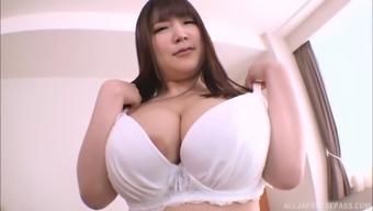 Pretty girl Yuzuki Dock enjoys it whenever pal pushes her tits