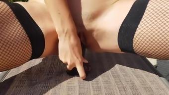 Hot milf walks in the backyard, whips herself and masturbates